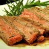 Tuscan Flank Steak Recipe and Video - Flavorful flank steak is marinated for several hours in a marinade of lemon zest, olive oil, rosemary, and garlic, then grilled to perfection.