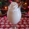 Luscious Eggnog Recipe - Whipped cream and rum are folded into a cooked vanilla custard in this version of the seasonal beverage. When serving, rest the bowl of eggnog in a bowl of ice.