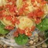 Cheese Ravioli with Fresh Tomato and Artichoke Sauce Recipe - The garden-fresh flavor of roma tomatoes is complimented by the tart notes of marinated artichokes in a delectable sauce that can be prepared in less time than it takes to cook up a package of fresh cheese ravioli.