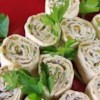 Mexican Cream Cheese Rollups Recipe - These south-of-the-border hors d'oeuvres -- with a cream cheese base -- are rolled up in tortillas, then sliced into bite-sized treasures.
