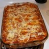 Layered Spinach Mostaccioli Recipe - Large tubes of mostaccioli are tossed with Parmesan cheese and spaghetti sauce, then layered with spinach and mozzarella cheese. Baked until bubbly, this casserole makes a hearty meal indeed.