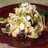 Easy Broccoli Slaw Salad Recipe - Ramen noodles, sliced almonds, raisins, and broccoli slaw come together for a crunchy and refreshing picnic salad.