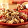Beef and Pasta Recipe - This one-skillet dinner combines Swanson(R) Vegetable Broth, seasoned ground beef, garlic, tomatoes and corkscrew pasta that simmer together to make a quick and delicious dish.