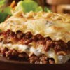 Hearty Lasagna Recipe - This classic lasagna casserole features ground beef in a perfectly seasoned pasta sauce layered with noodles and traditional Italian cheeses.