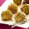 Almond Crusted Chevre and Grape Truffles Recipe - A savory-sweet appetizer that looks like a candy truffle is really a juicy grape in a goat cheese coating, rolled in toasted almonds and chives.