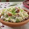 Rosemary Smashed Potatoes Recipe - Red potatoes are roasted with rosemary and olive oil, then mashed lightly and seasoned with sour cream, butter, and green onions.