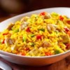Cheesy Chicken and Yellow Rice Recipe - Give your everyday chicken and rice dinner a makeover with this deliciously cheesy chicken and yellow rice recipe. Simply stir flavor-packed GOYA(R) Yellow Rice with seasoned chicken breasts, veggies, and a handful of cheddar cheese. In 30 minutes, you have an easy, comforting weeknight meal that will chase the blahs away!