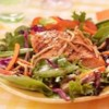 Grilled Salmon, Snap Peas and Spring Mix Salad with Chow Mein Noodles Recipe - Salmon fillets are grilled and brushed with an Asian-inspired sauce then served on fresh salad greens with snap peas tossed with Asian Vinaigrette.