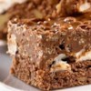 Chocolate Dream Bars Recipe - Marshmallows and semi-sweet chocolate make these yummy bars a dream come true.