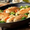 Garlic Chicken, Vegetable and Rice Skillet Recipe - You've got everything you need in just one-skillet . . . garlic-seasoned chicken breasts on a bed of rice mixed with colorful vegetables.  Getting dinner on the table couldn't be easier . . . and it tastes great too.