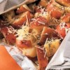 Perfect Garlic and Parmesan Potatoes Recipe - Red potatoes seasoned with rosemary and garlic are cooked in a sealed foil packet and served with grated Parmesan cheese for an easy and delicious side dish.