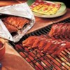 Baby Back Barbecue Ribs Recipe - Easy and delicious, seasoned baby back ribs are sealed in foil and cooked until tender, then finished on the grill with barbecue sauce.