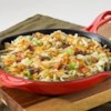 30 Minute Irish Skillet Recipe - A touch of bacon and a splash of apple juice enhance the savory flavors in this traditional beef, potato and cabbage dish. Enjoy this easy skillet dinner on nights when there's no time to cook.