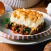 Sausage Shepherds Pie Recipe - This meal has everything you need all in one dish. Sausage and vegetables are nestled in gravy and baked under a mashed potato crust.