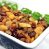 Calico Bean Casserole Recipe and Video - Kidney beans, baked beans and butter beans are combined with ground beef, bacon and onion in this hearty dish. You can also put the ingredients into a slow cooker and cook for about 8 hours on low.