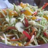 Sweet and Crunchy Salad Recipe - The dressing is sweet and the salad is crunchy  - hence the name of this tasty salad. A bit of sugar sweetens the herbed vinegar and oil dressing, and sunflower seeds, ramen noodles, cashews, and water chestnuts add the crunch in the coleslaw salad.