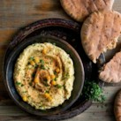 Middle Eastern Mezze Recipes Slideshow - Turkish, Lebanese and other Middle Eastern flavors star in these healthy recipes for appetizers, dinner, side dishes and more. Mezze, also spelled meze, means small plates to share–which are served similar to tapas. We like to serve these flavorful Middle Eastern recipes like tapas or as sides to shish kebabs, lamb, chicken or fish. Try the best hummus we've ever made, slow-roasted tomato sauce (Matbucha), cauliflower salad with walnuts and more with these healthy favorites.