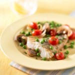 Oven-Roasted Fish with Peas and Tomatoes