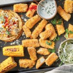 Crispy Fish Tacos with Charred Corn & Crema