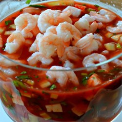 Original Mexican Shrimp Cocktail Recipe - Shrimp with tomatoes, avocados, sweet onion, and cilantro bask in a zesty tomato salsa for an appetizer that looks beautiful when served in a glass salad bowl. Serve with saltine crackers.
