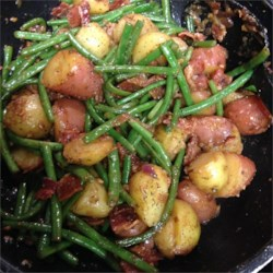 Southern Green Beans Recipe - Fresh green beans get extra heartiness from new potatoes, and extra flavor from bacon, onion, and white balsamic vinegar.