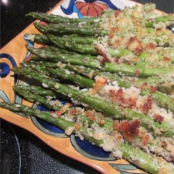 Parmesan-Panko Asparagus Spears Recipe - Asparagus spears are dipped in an egg white-mayonnaise mixture and then coated in Parmesan cheese and panko breadcrumbs before taking a trip to the oven for a crunchy, delicious side dish.