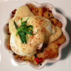 Savory Bacon and Crab Bread Pudding Eggs Benedict Recipe - Smoky bacon and sweet crab make this bread pudding a flavorful twist on a classic Eggs Benedict. Try this elegant dish for a special breakfast or brunch.