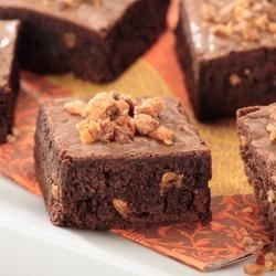 Chocolate Butterfinger Brownies Recipe - Topped with chopped Butterfinger candy bar pieces, this classic chocolate brownie adds a festive flair to a celebration. Try cutting each brownie into bite size pieces for a crunchy treat!