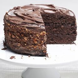 Chocolate Buttermilk Layer Cake Recipe - Buttermilk is beloved in recipes for its ability to make rich, moist cakes. This chocolate buttermilk layer cake uses a variety of your favorite chopped candy bars sprinkled between each layer and as a coating for a sweet, crunchy surprise. This will quickly become a family favorite.