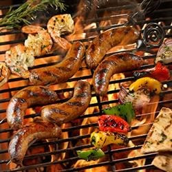 Grilled Sausage with Marinated Shrimp, Peppers and Onions Recipe - Skewers of hot Italian sausage, marinated shrimp, and crunchy fresh veggies are quickly grilled up and served with grilled pita bread.