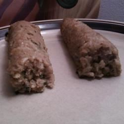 Cajun Boudin Recipe - This typical Cajun sausage is stuffed with ground pork, rice, and the holy trinity of onion, bell pepper, and celery.