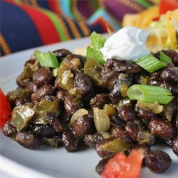 Black Beans Recipe - Black beans cooked with onion, green pepper and garlic, seasoned with bay leaves, salt, cumin, and oregano. White wine and vinegar give these beans a nice little bite.