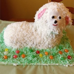 Coconut Lamb Cake Recipe - White Cake for Lamb Mold. Reserve some coconut to tint green and arrange around mold as grass. Use raisins for eyes and nose and a slice of maraschino cherry for the mouth.
