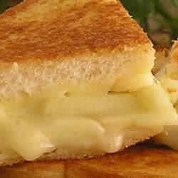 Grilled Apple and Swiss Cheese Sandwich Recipe - My mother taught me this recipe, and it has become one of my favorite quick meals. I find that Granny Smith apples work best, as well as a crunchy seed bread.