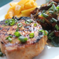 Grilled Asian Ginger Pork Chops Recipe - Ginger, garlic, and orange give these grilled chops lots of unique flavour. They can also be put in the oven and broiled.