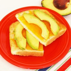 Avocado Toast Recipe - Cheddar cheese is toasted on bread and topped with avocado slices for a quick and easy snack that will keep you full.