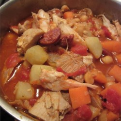 Spanish-Style Chicken Stew Recipe - This spicy, warming stew of chicken thighs chorizo sausage, and paprika will spice up a winter evening.