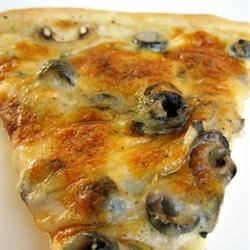Spinach Alfredo Pizza Recipe - A delicious variation to your everyday pizza made with spinach mushrooms and artichoke hearts. Very simple!