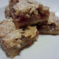 Cherry Coconut Bars Recipe - Shortbread-type base with a coconut, nuts, and cherry meringue-type topping