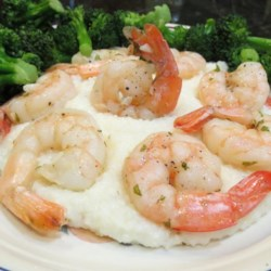 Lemon-Garlic Shrimp and Grits Recipe - Garlic and the fresh taste of lemon flavor these easy shrimp served over bowls of hot cooked grits.