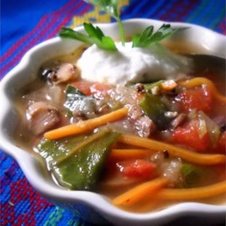 Spicy and Creamy Vegetable Soup Recipe - Spice up this Italian-inspired vegetable soup with canned tomatoes with hot chilies, and then smooth it out with a little bit of cream.