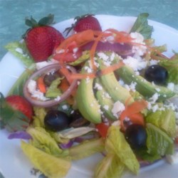 Huge Rainbow Salad Recipe - A bright and colorful salad of spinach and lettuce is topped with pretty bell peppers, avocado, cauliflower, and broccoli for a rainbow of delicious veggies. Serve drizzled with your choice of dressing.