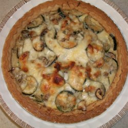 Summertime Zucchini Pie Recipe - This quiche-like dish featuring zucchini, bacon, and mushrooms is great for a light lunch or brunch.