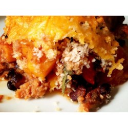 Spicy Southwest Squash Casserole Recipe - Squash, tomatoes with green chile peppers, and black beans are baked with plenty of spices creating a tasty Southwestern squash casserole perfect for your vegetarian family and friends.