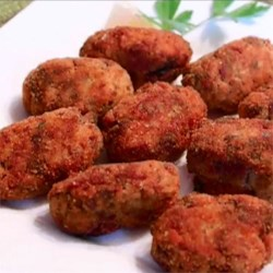 Italian Rice Croquettes Recipe - Try this tasty recipe for fried rice croquettes filled with Parmesan cheese and marinara sauce.