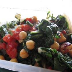 Swiss Chard with Garbanzo Beans and Fresh Tomatoes Recipe - Beans and greens are a perfect combination; earthy and satisfying. This recipe for Swiss chard with garbanzo beans, onion, and fresh tomato is brightened with lemon juice and makes a perfect vegetarian main dish or a tantalizing side dish for fish or meat.