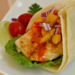 Halibut Soft Tacos Recipe - Grilled halibut fills these fish tacos topped with a fresh-made mango salsa.