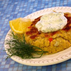 Salmon Patties With Dill Sauce Recipe - Easy salmon patties are pan-fried and served alongside a simple sour cream and dill sauce perfect for appetizers or a simple main dish.