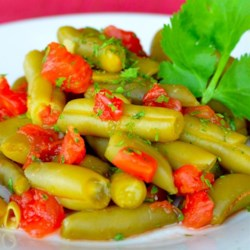 Hot and Spicy Green Beans with Tomato Recipe - Spice up a can of green beans with red pepper flakes and diced tomatoes for a quick and easy side dish for camping or weeknight dinner.