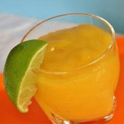Mango Lime Smoothie Recipe - Fresh mangoes are blended with a little confectioners' sugar, lime juice, and ice to create a refreshing summer fruit drink.